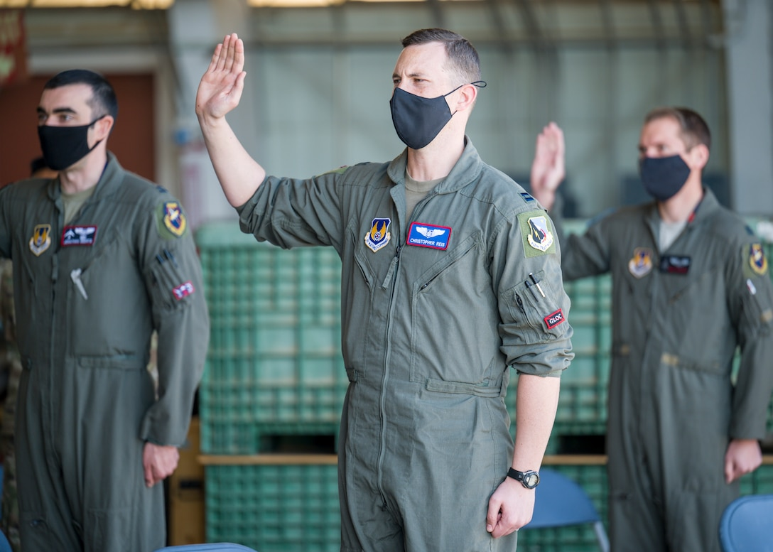 Capt. Christopher Reis, recites the oath of office during a Space Force Transfer Ceremony at Edwards Air Force Base, California, Feb. 11. (Air Force photo by Giancarlo Casem)