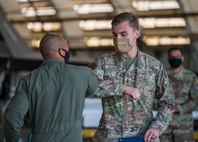 1st Lt. Lucas Schaper, Space Test Fundamentals Class 21-1, U.S. Air Force Test Pilot School, is congratulated by Col. Randel Gordon, 412th Test Wing Vice Commander, during a Space Force Transfer Ceremony at Edwards Air Force Base, California, Feb. 11. (Air Force photo by Giancarlo Casem)