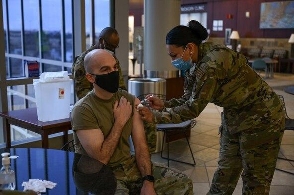 Airmen receive COVID-19 vaccination