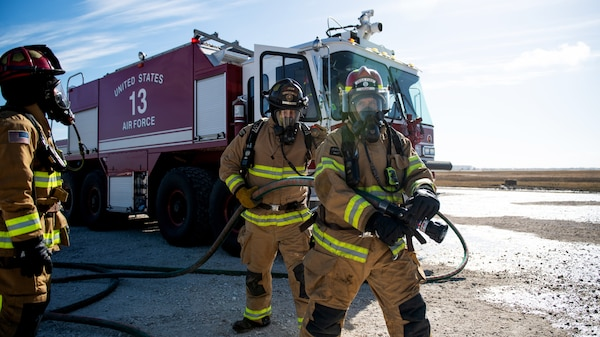 Firefighters with Joint Base San Antonio extinguish an isolated fire during a live fire Aircraft Rescue Fire Fighting training Nov. 20, 2020, at Joint Base San Antonio-Kelly Field, Texas.