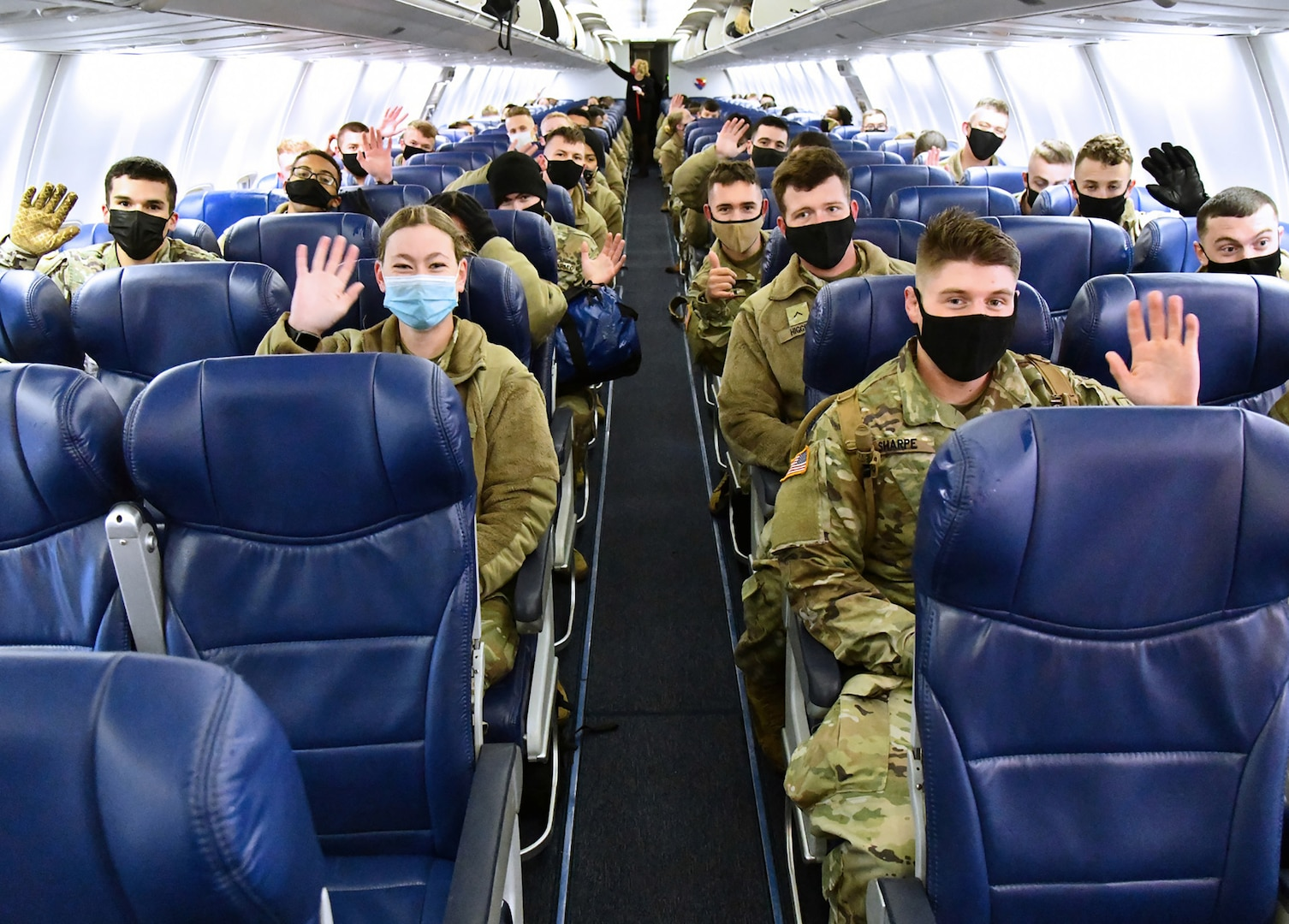 U.S. Army Medical Center of Excellence Advanced Individual Training Soldiers wave once aboard a contract airplane at Joint Base San Antonio-Kelly Field Annex that will take them to their first duty assignment.