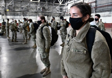 U.S. Army Medical Center of Excellence Advanced Individual Training Soldiers line up in formation at Joint Base San Antonio-Kelly Field Annex before boarding a contract airplane that will take them to their first duty assignment.