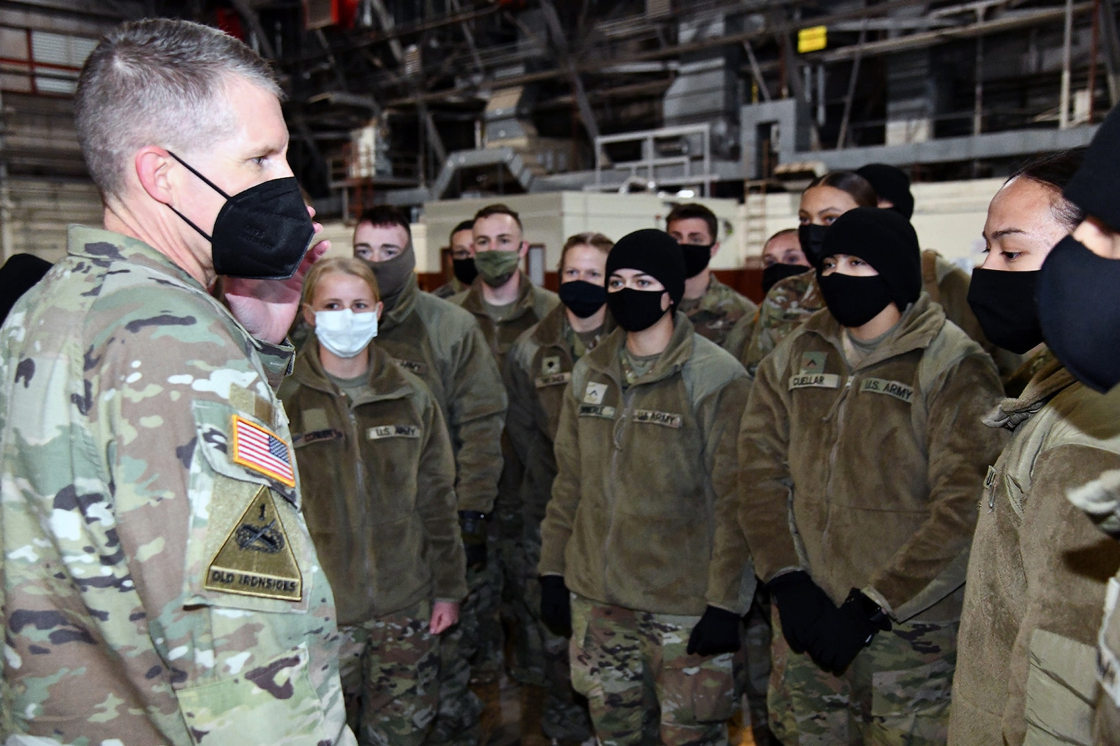 U.S. Army Medical Center of Excellence Command Sgt. Maj. Clark Charpentier speaks to Advanced Individual Training Soldiers departing Joint Base San Antonio to their first assignment.