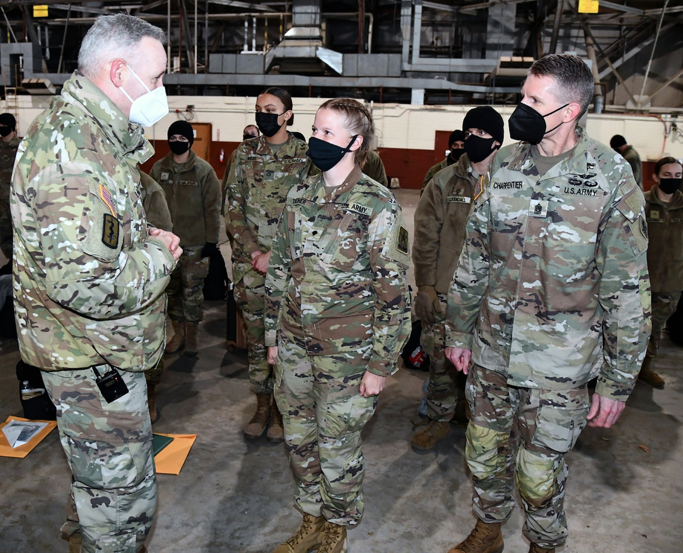 Spc. Angela Thresher (center), a 68W Combat Medic who was identified as the 10,000th Soldier to depart from the U.S. Army Medical Center of Excellence in a controlled manner as part of the COVID-19 pandemic, speaks with Maj. Gen. Dennis LeMaster, MEDCoE commanding general and MEDCoE Command Sgt. Maj. Clark Charpentier.