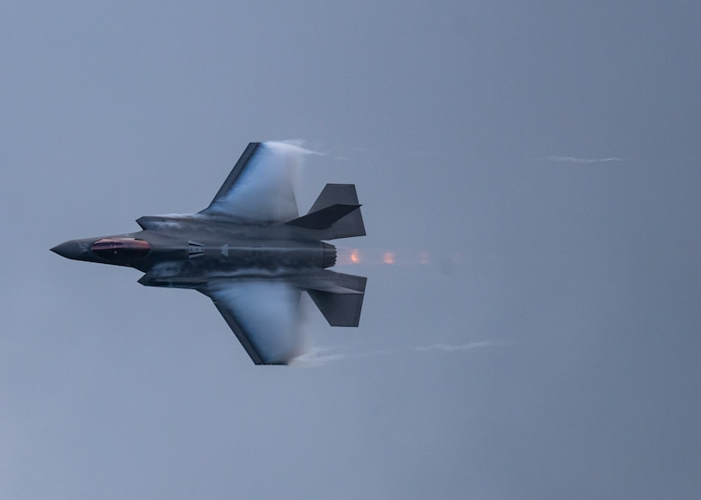 An F-35 from the F-35 Demonstration Team flies through the sky.