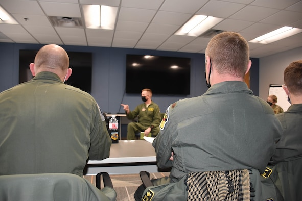 A group of US Air Force captains and majors listen to a presentation during the 3-day Officer Development Course.