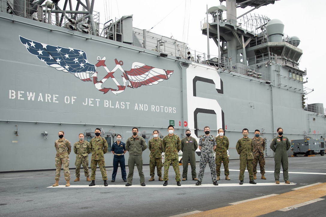 U.S. Marines and Sailors stand together with members of the Japanese Ground Self Defense Force, Australian Navy, U.S. Space Force, and U.S. Air Force, embarked together aboard amphibious assault ship USS America (LHA 6) in the Philippine Sea, Jan. 21.