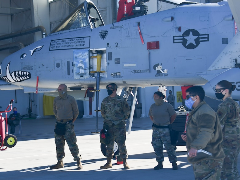 924th Aircraft Maintenance Unit load crew stand beside A-10 Thunderbolt II