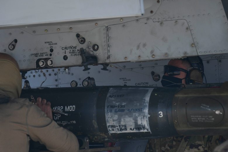 U.S. Air Force Airmen secure munitions to A-10 Thunderbolt II