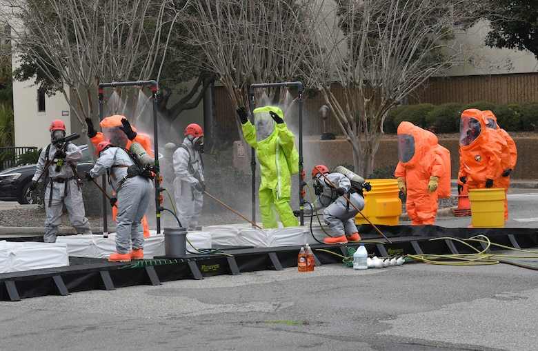Emergency response team members walk through a decontamination line outside the Keesler Medical Center at Keesler Air Force Base, Mississippi, Feb. 11, 2021. Members of the Keesler Fire Department, 81st Security Forces Squadron, 81st Medical Group and Emergency Management responded to a suspicious package found inside the Keesler Medical Center. (U.S. Air Force photo by Kemberly Groue)