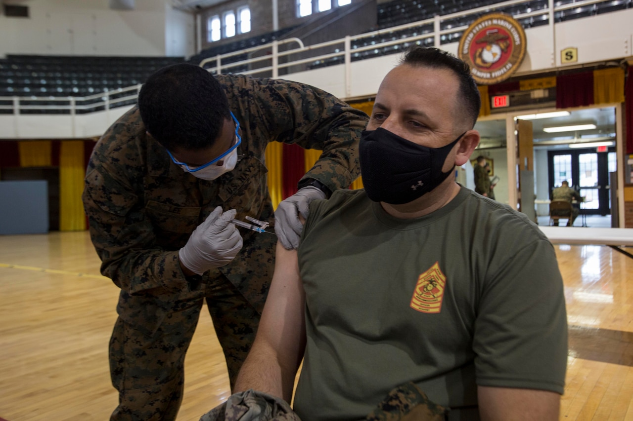 A man gets an injection in his arm.