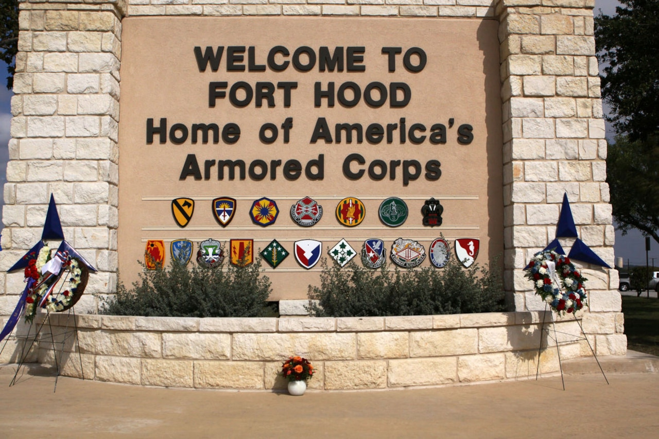 A large welcome sign bears the name of Fort Hood, Texas.