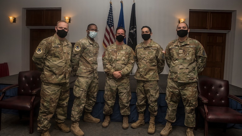 Airmen pose for a photo