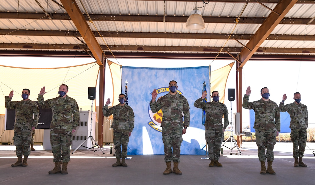 Members from the 607th Air Control Squadron recite the Oath of Office during a ceremonial swear-in, Feb. 5, 2021, at Luke Air Force Base, Arizona.
