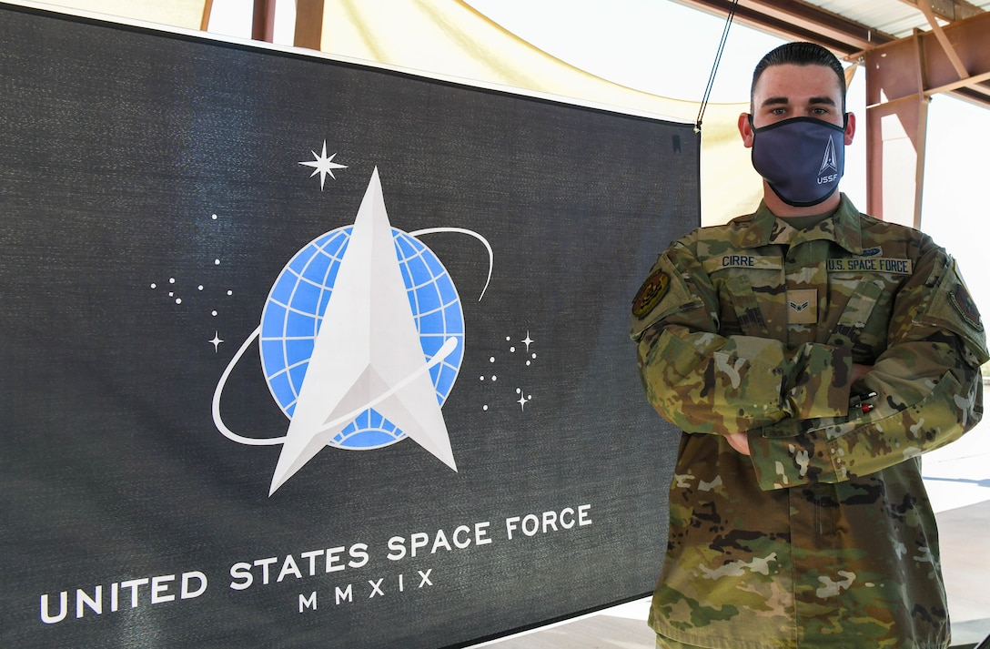 Airman 1st Class Caleb E. Cirre, 607th Air Control Squadron cyber transport systems specialist, poses with the U.S. Space Force flag after a ceremonial swear-in, Feb. 5, 2021, at Luke Air Force Base, Arizona.