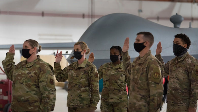 Holloman Air Force Base and Fort Bliss, Texas, Airmen take the Oath of Enlistment during U.S. Space Force transfer ceremony, Feb. 12, 2021, on Holloman Air Force Base, New Mexico. A total of 19 Airmen were chosen to transfer over to the U.S. Space Force. (U.S. Air Force photo by Airman 1st Class Jessica Sanchez)