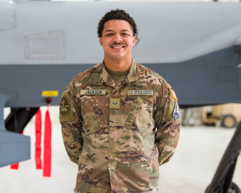 U.S. Space Force Specialist 4 Bronze Jackson, 49th Aircraft Maintenance Squadron, poses for a photo Feb. 12, 2021, on Holloman Air Force Base, New Mexico. The USSF is currently working on transferring over 6,000 Airmen from the Air Force to the Space Force by mid-2021. In Sept. 2020, the Air Force transitioned more than 2,400 active-duty Airmen in space operations and space system operations to begin establishing, maintaining, and preserving U.S. freedom of operations in space. (U.S. Air Force photo by Airman 1st Class Jessica Sanchez)