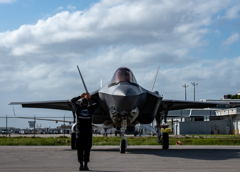 An Air Force maintainer stands in front of an F-35A Lightning II