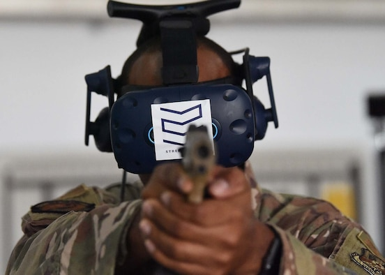 U.S. Air Force Master Sgt. Kenneth Greene, 380th Expeditionary Security Forces Squadron training NCO in charge, points a simulated M-18 while wearing a virtual reality (VR) system at Al Dhafra Air Base (ADAB), United Arab Emirates, Jan. 20, 2020.