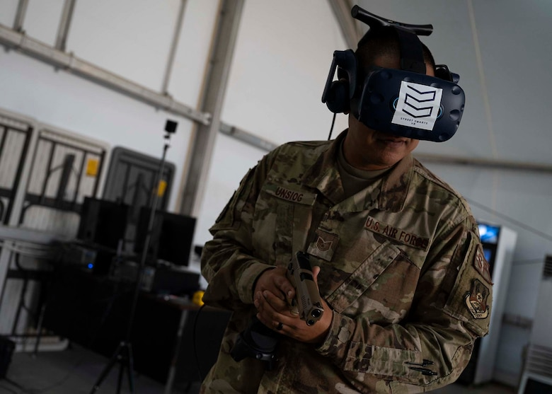 U.S. Air Force Tech. Sgt. Frank Unsioug, 380th Expeditionary Security Forces Squadron combat arms instructor, uses a virtual reality (VR) system in a simulated response at Al Dhafra Air Base, United Arab Emirates, Jan. 20, 2020.