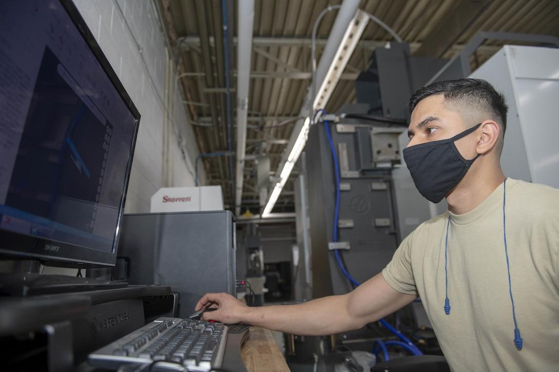 Photo of Airman using computer.