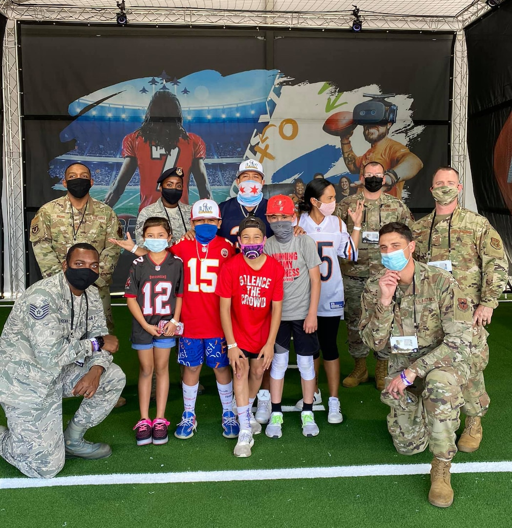 Total Force recruiters posed with a group of fans at the Super Bowl LV Experience outside of Raymond James Stadium in Tampa, Florida, Jan. 31, 2021.