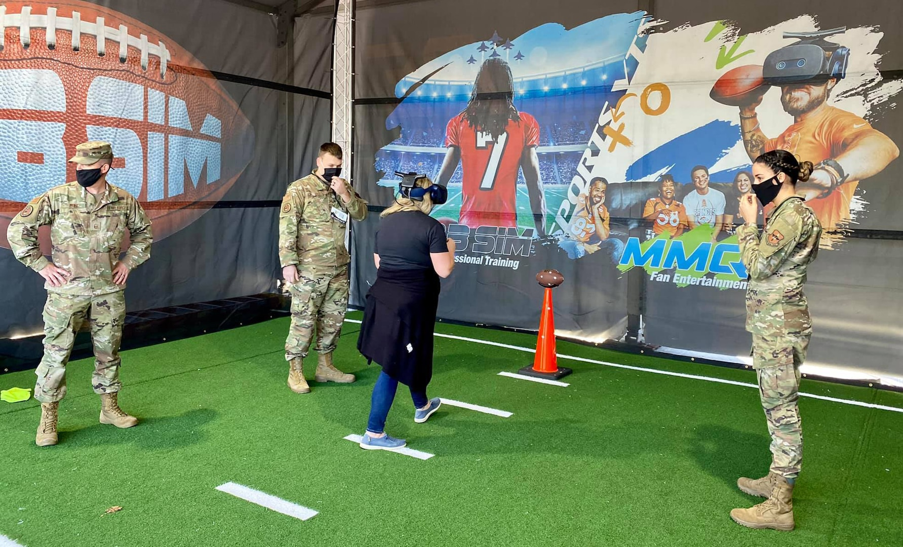 Total Force recruiters assisted a fan with the AIR RAID QB SIM Experience at the Super Bowl LV Experience outside of Raymond James Stadium in Tampa, Florida, Jan. 31, 2021.