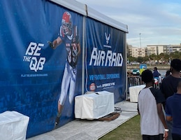 Super Bowl fans wait in line to experience the Air Force's AIR RAID QB SIM Experience at the Super Bowl LV experience outside of Raymond James Stadium in Tampa, Florida, Jan. 31, 2021.