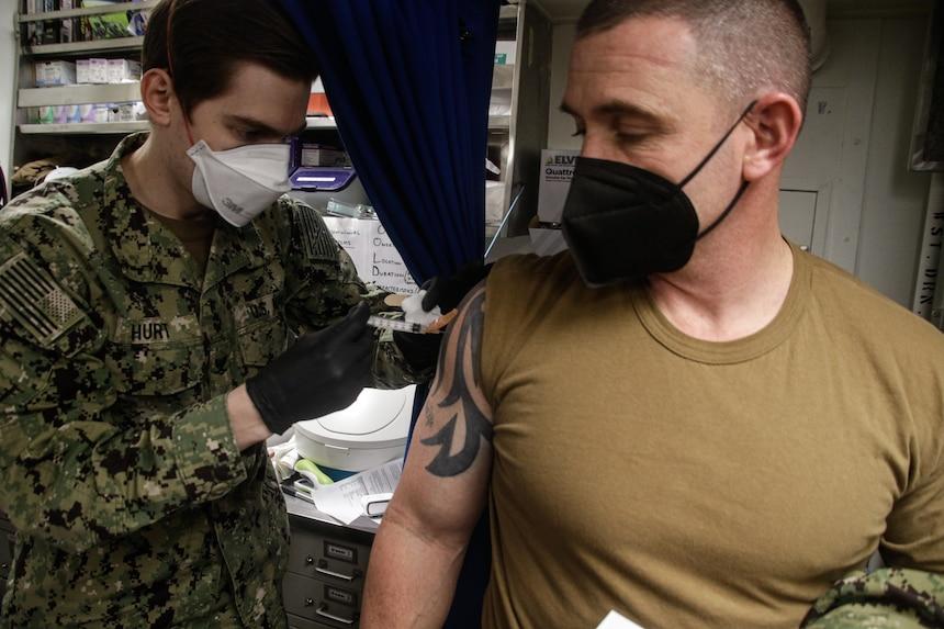 Sailors receive the COVID-19 vaccine aboard USS Mahan (DDG 72).