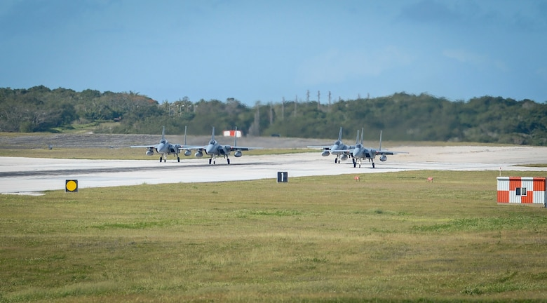 Four Japan Air Self-Defense Force, or Koku-Jieitai, F-15J Eagles assigned to the 201st Squadron, Chitose Air Base, Japan, taxi on the flight line during exercise Cope North 2021 at Andersen Air Force Base, Guam, Feb. 11, 2021.