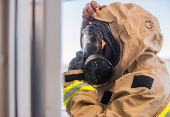 Staff Sgt. Mohamed Musa, from the Oregon National Guard 102nd CST, dons HAZMAT gear during the BAYEX 2021 exercise with CST units from Oregon, Nevada and California in Northern California Feb. 1-5, 2021. The exercise tested the ability to respond to training scenarios in the San Francisco Bay Area involving weapons of mass destruction emergencies.