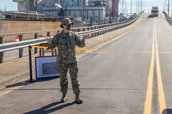 Norfolk Naval Shipyard (NNSY) Commander, Captain Dianna Wolfson, addresses shipyard personnel during a ribbon cutting ceremony Feb. 4. The ribbon cutting ceremony celebrates the completion of the $6,460,230 Borum Overpass restoration project.