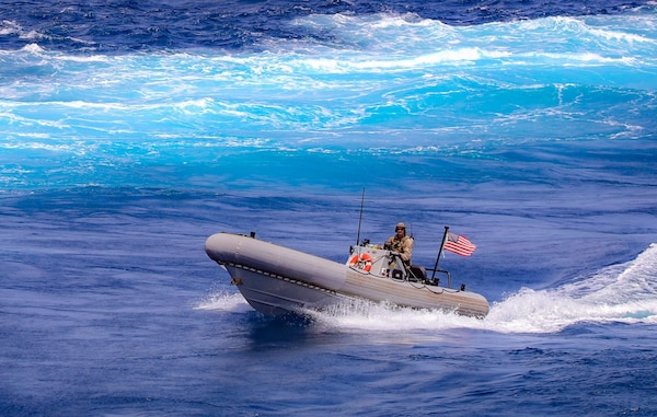 A Sailor assigned to the guided-missile destroyer USS Winston S. Churchill (DDG 81), in accordance with international law, boarded a stateless dhow off the coast of Somalia and interdicted an illicit shipment of weapons and weapon components, Feb. 12.