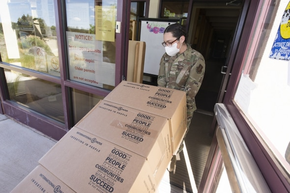 Members from the 150th Mission Support Group work with the 210th Rapid Engineer Deployable Heavy Operational Repair Squadron Engineers Squadron to complete food delivery missions in Santa Fe, New Mexico, in response to the New Mexico National Guard Joint Task Force Mission. Ryan Black, acquisition program manager with the 704th Test Group, a unit of Arnold Engineering Development Complex based at Holloman Air Force Base, New Mexico, was among those who helped deliver food, water and personal protective equipment to residents of New Mexico during the statewide COVID-19 response effort. (Photo by Tech. Sgt. Franchesca Pancham/150th Special Operations Wing)