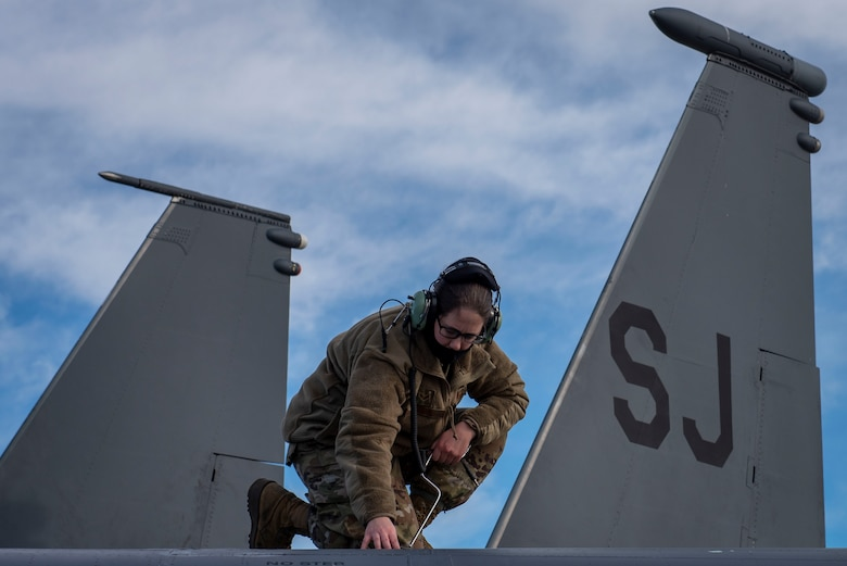 Senior Airman Kierra Hamil, 4th Component Maintenance Squadron electrical and environmental technician, removes a panel from an F-15E Strike Eagle at Seymour Johnson Air Force Base, North Carolina, Feb. 3, 2021.