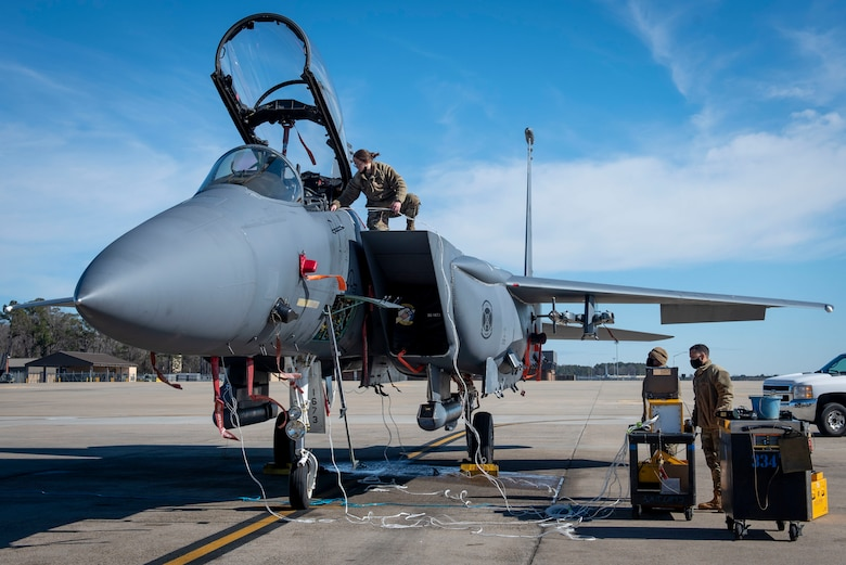 Senior Airman Kierra Hamil (left), 4th Component Maintenance Squadron electrical and environmental technician, connects a test harness to an F-15E Strike Eagle while Airman 1st Class Quentin Thompson (middle), 4th CMS electrical and environmental technician, and Senior Airman Thiago Santos (right), 4th Fighter Readiness Squadron electronics technician, set up an Eclypse tester program at Seymour Johnson Air Force Base, North Carolina, Feb. 3, 2021.