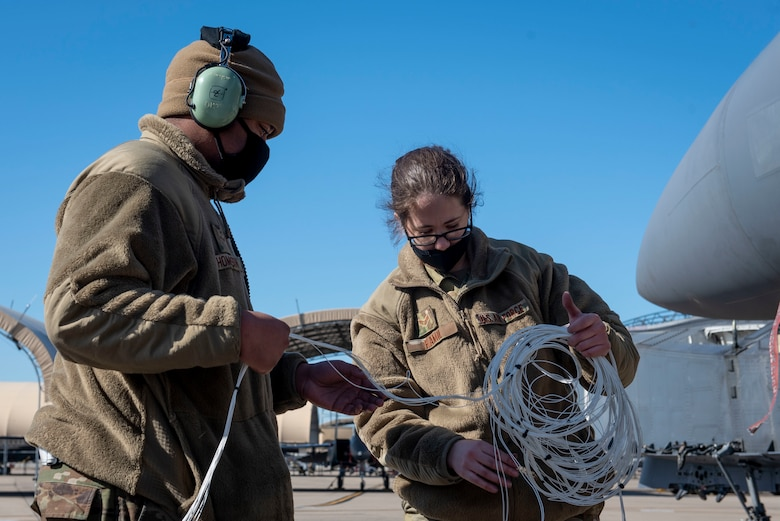 Airman 1st Class Quentin Thompson (left) and Senior Airman Kierra Hamil (right), 4th Component Maintenance Squadron electrical and environmental technicians, organize and lay out test harnesses at Seymour Johnson Air Force Base, North Carolina, Feb. 3, 2021.