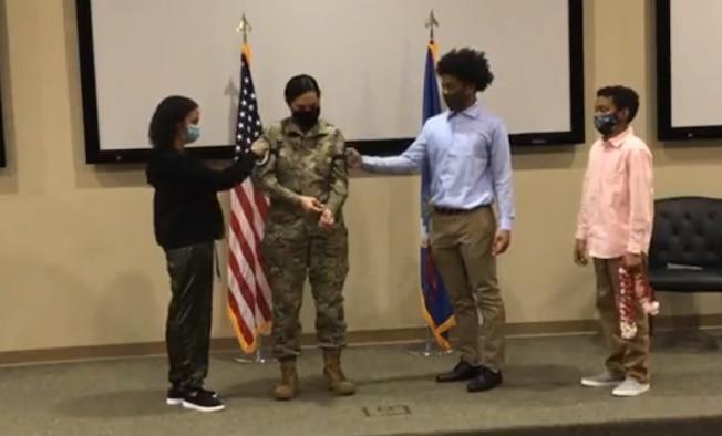 Photo: Family places new rank insignia on Chief Migo