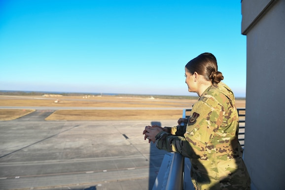 2nd Lt. Colleen Kuykendall looks at the flight line from the air traffic control tower.