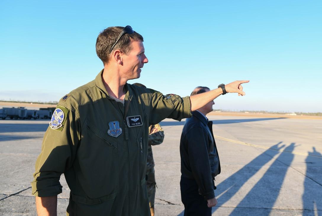 Lt. Col. Richard Wilson points to the flight line.