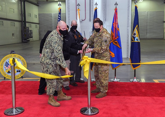Leaders at Corpus Christi Naval Air Station hosted a ribbon cutting ceremony, Feb. 12, 2021, to commemorate the completion of the Aircraft Corrosion Control Facility at Corpus Christi Army Depot, located in Corpus Christi, Texas.   Pictured left to right: Col. Kenneth Reed, director of the Fort Worth District of the U.S. Army Corps of Engineers; Atanacio Carrisal, senior project manager for construction partner, AMSTAR, Inc.; Capt. Christopher Jason, commanding officer NAS Corpus Christi; Cmdr. Eric Hass, public works officer; and Col. Joseph Parker, CCAD commander.
