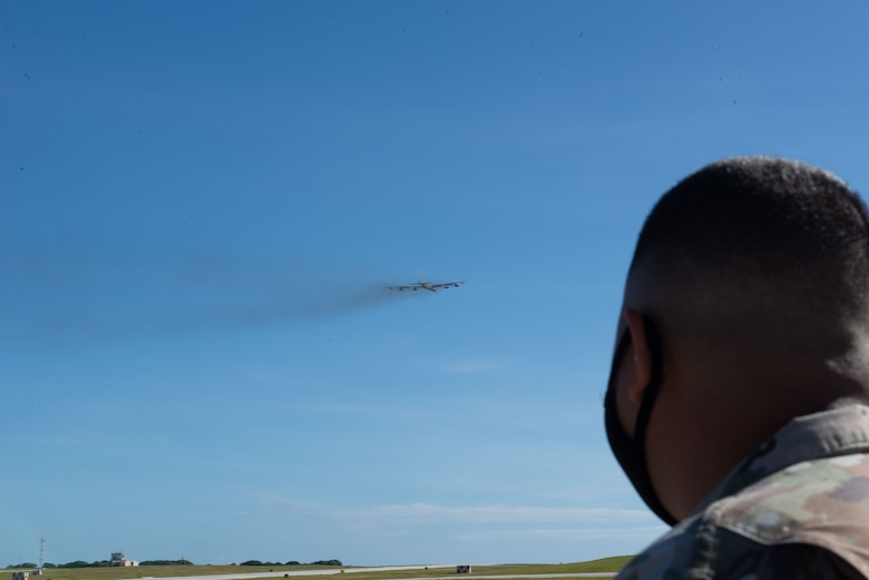 Staff Sergeant Ian Leyco, 36th Contingency Response Group, watches a B-52 Stratofortress take off from Andersen Air Force Base, Guam, Feb. 10, 2021.