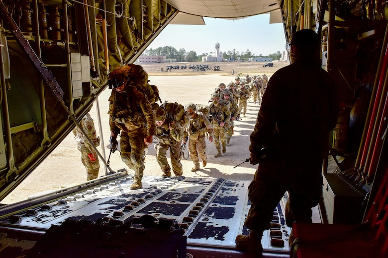Soldiers board a plane