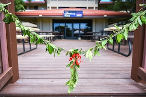 A Hawaiian lei rests in the entryway of the Gathering Place at Joint Base Pearl Harbor-Hickam, Hawaii, Feb. 11, 2021. The Gathering Place serves as a joint operation, giving Airmen, Soldiers, Sailors, and Guardians an opportunity to connect in a singular effort to ease the stressors of integrating servicemembers into a new and much bigger military family. (U.S. Air Force photo by Tech. Sgt. Anthony Nelson Jr.)