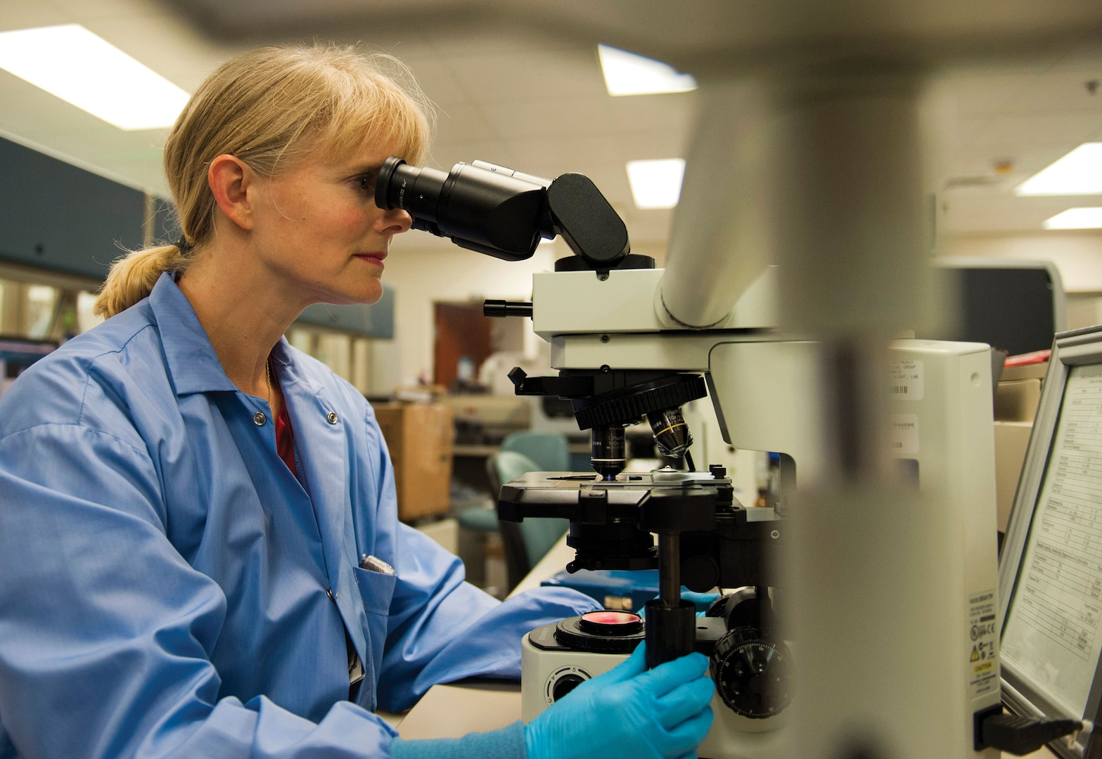 Dolli Lane, 96th Medical Group laboratory technician, reviews sample through microscope November 19, 2015, at Eglin Air Force Base, Florida, after recently discovering rare spirally twisted bacteria, known to cause tickborne relapsing fever, and cultured by Centers for Disease Control (U.S. Air Force/Ilka Cole)