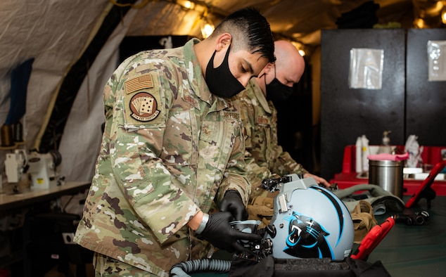 Airmen from the 378th Expeditionary Fighter Squadron aircrew flight equipment perform maintenance on equipment Feb. 11, 2021, at Prince Sultan Air Base, Kingdom of Saudi Arabia.