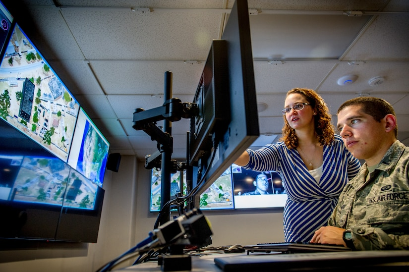 Associate research engineer Cassandra Stanfill, with Intelligence, Surveillance Augmentation, and Reconnaissance Branch, uses eye-tracking technology, among other methods, on test subject, Lieutenant Michael Emard, at Air Force Research Laboratory, Wright Patterson Air Force Base, Dayton, Ohio, July 21, 2016 (U.S. Air Force/J.M. Eddins, Jr.)