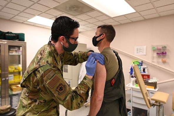 U.S. Air Force Staff Sgt. Matthew Hartwig, 173rd Medical Group, administers the COVID-19 vaccine to Col. Jeff Edwards, 173rd Fighter Wing commander, Feb. 12, 2021, at Kingsley Field in Klamath Falls, Oregon. About 100 doses of the vaccine were administered to volunteer members of the Oregon National Guard.