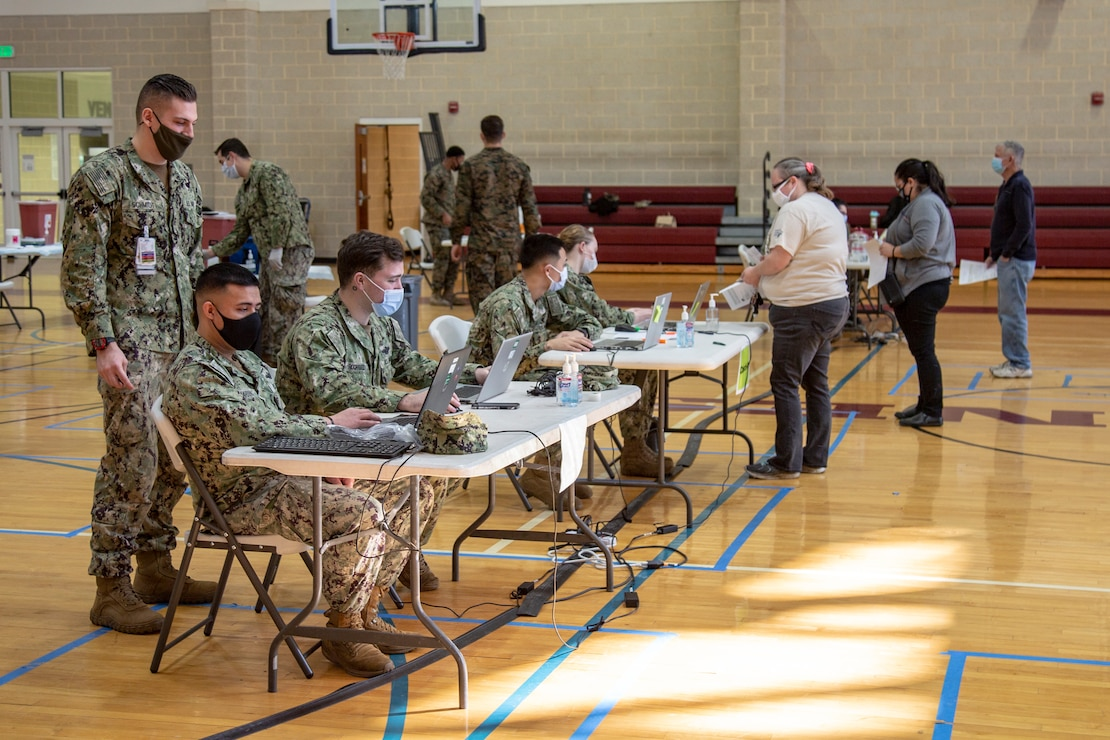 Vaccination stations have been set up at Wallace Creek Fitness Center gym which is now operating as a mass COVID-19 vaccination center to support Marine Corps Installations East personnel and beneficiaries on Marine Corps Base Camp Lejeune, North Carolina, Feb. 16, 2021. Beginning Feb. 16, 2021, Naval Medical Center Camp Lejeune personnel will be able to provide vaccinations for any eligible personnel with the capability of vaccinating up to 2000 people per day. (U.S. Marine Corps Photo by Lance Cpl. Isaiah Gomez)