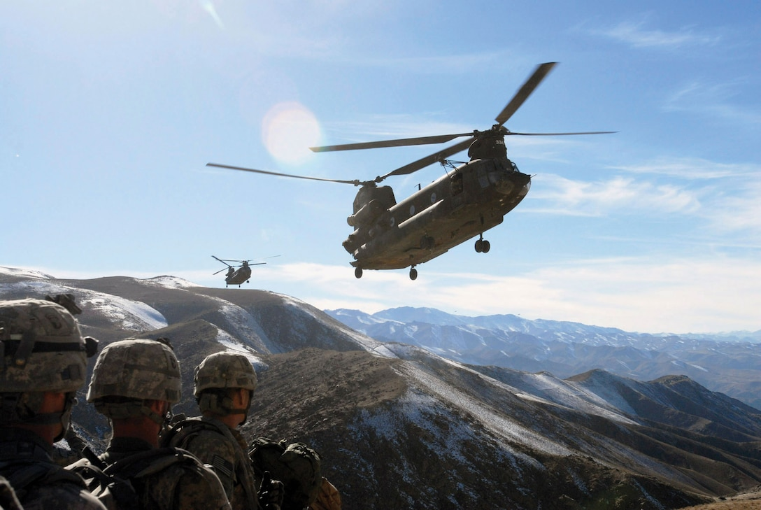 Soldiers with 101st Division Special Troops Battalion, 101st Airborne Division, watch as two Chinook helicopters fly in to return them to Bagram Airfield, Afghanistan, November 4, 2008 (U.S. Army/Mary L. Gonzalez)